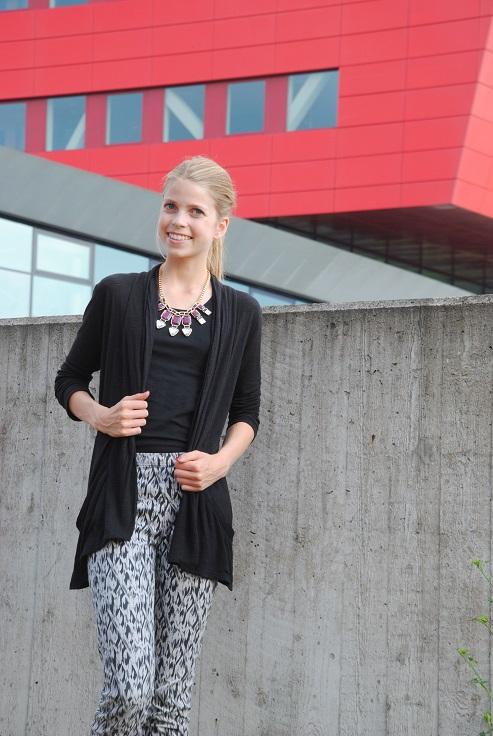 Outfit lang zwart vest